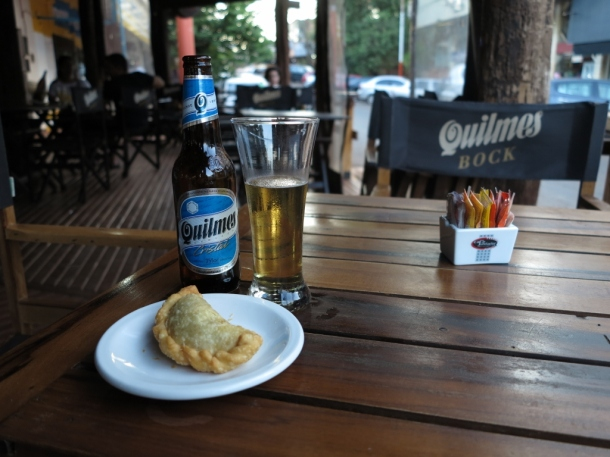 Quilmes is the national beer and it has a massive marketing upperhand. Alongside, an empanada. Both are very close to my heart.