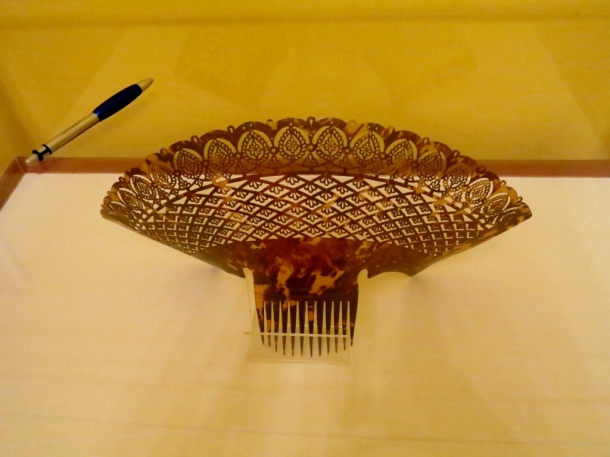 Some kind of hair ornament from long ago. Pen for scale