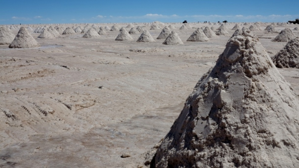 """Tour operators sell these as the """"salt mountains"""" but really they're just mounds scraped together by miners"""