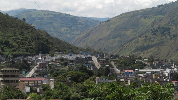 "The ride from Quito can't be more than three hours, and the walk from Baños' ""bus terminal"" couldn't have taken more than five minutes. We got a room with a spectacular view of waterfalls."